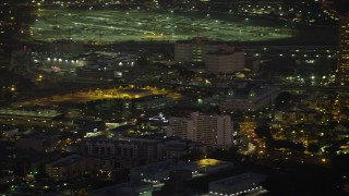 AX64_0251 - 5K stock footage aerial video of tracking a police helicopter flying over Downtown Los Angeles, California, Night