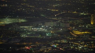 AX64_0255 - 5K stock footage aerial video of helicopter flying toward Twin Towers Correctional Facility prison, Downtown Los Angeles, California, Night