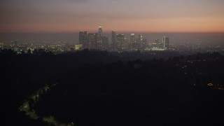 AX64_0256 - 5K stock footage aerial video of Downtown Los Angeles skyline at twilight, California