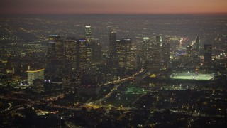 AX64_0262 - 5K stock footage aerial video approach Downtown Los Angeles skyscrapers at twilight in California