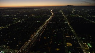 AX64_0275 - 5K stock footage aerial video of heavy traffic on Interstate 10 through Pico-Union, Los Angeles, California, twilight
