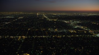 AX64_0279 - 5K stock footage aerial video of West Adams neighborhood around Crenshaw Boulevard in Los Angeles, California, night