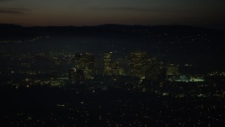 AX64_0284 - 5K stock footage aerial video of passing Century City skyscrapers at night, Los Angeles, California