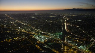 AX64_0285 - 5K stock footage aerial video of Venice Boulevard between car dealerships and apartment buildings in Palms, Los Angeles, California, twilight