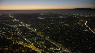 AX64_0286 - 5K stock footage aerial video of Venice Boulevard through Palms, Los Angeles, California, twilight