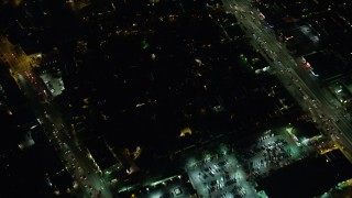 AX64_0289 - 5K stock footage aerial video of bird's eye view of a neighborhood beside Venice Boulevard in Palms, Los Angeles, California, night
