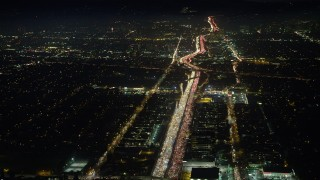 AX64_0290 - 5K stock footage aerial video of heavy traffic on I-405 freeway through Sawtelle, Los Angeles, California, night
