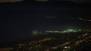 AX64_0296 - 5K stock footage aerial video of Santa Monica Pier rides and the Pacific Wheel at night, Los Angeles, California