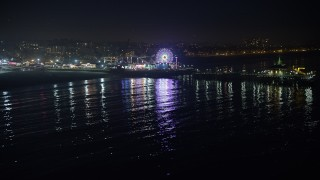 AX64_0306 - 5K stock footage aerial video approach the Pacific Wheel at Santa Monica Pier, Los Angeles, California, night