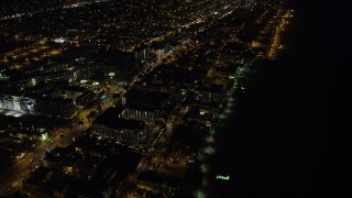 AX64_0308 - 5K stock footage aerial video of Ocean Avenue and Loews Santa Monica Beach Hotel, Santa Monica, California, night