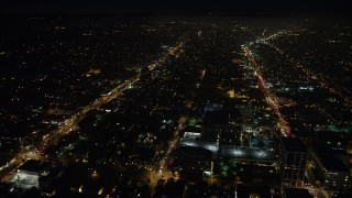 AX64_0312 - 5K stock footage aerial video fly over buildings between Santa Monica and Wilshire Boulevard, Santa Monica, California at night