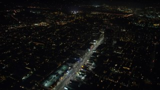 AX64_0316 - 5K stock footage aerial video of following Wilshire Boulevard toward office buildings in Sawtelle, Los Angeles, California at night
