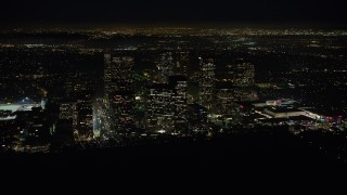 AX64_0323 - 5K stock footage aerial video of skyscrapers in the Century City area of Los Angeles, California, night