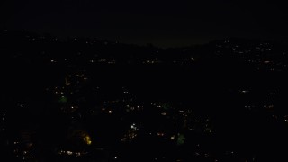 AX64_0331 - 5K stock footage aerial video of residential lights from hillside mansions in Hollywood Hills, Los Angeles, California, night