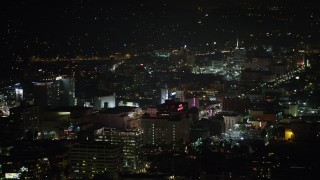 AX64_0333 - 5K stock footage aerial video of Roosevelt Hotel and office buildings in Hollywood, California, night