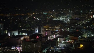 AX64_0334 - 5K stock footage aerial video of Roosevelt Hotel and office buildings on Hollywood Boulevard, Hollywood, California, night