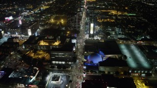 AX64_0337 - 5K stock footage aerial video follow Sunset Boulevard and fly over ArcLight Hollywood, California, night