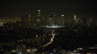 AX64_0348 - 5K stock footage aerial video of Downtown Los Angeles skyline viewed from Echo Lake, California, night