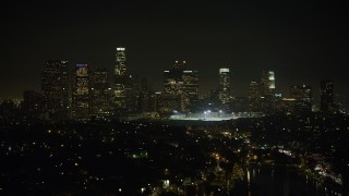 AX64_0350 - 5K stock footage aerial video approach Downtown Los Angeles skyline from Echo Lake, California, night