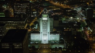 AX64_0368 - 5K stock footage aerial video of Los Angeles City Hall at night, Downtown Los Angeles, California