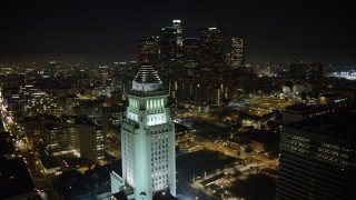AX64_0370 - 5K stock footage aerial video flyby Los Angeles City Hall to focus on the Downtown Los Angeles skyline, California, night