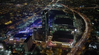 AX64_0375 - 5K stock footage aerial video flyby JW Marriott, The Ritz-Carlton Hotel and Staples Center in Downtown Los Angeles, California, night