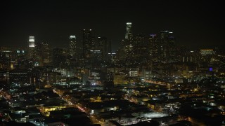 AX64_0387 - 5K stock footage aerial video of a view north at the Downtown Los Angeles skyline, California, night