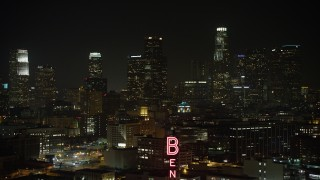 AX64_0390 - 5K stock footage aerial video of flying toward the Downtown Los Angeles skyline, California, night