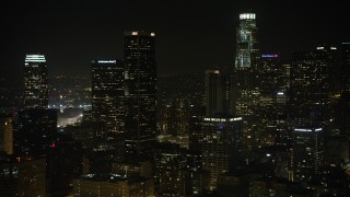 AX64_0391 - 5K stock footage aerial video approach Aon Center in Downtown Los Angeles, California, night