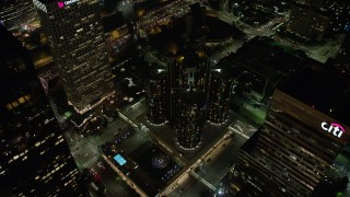 AX64_0394 - 5K stock footage aerial video tilt to bird's eye of Westin Bonaventure Hotel and city streets, Downtown Los Angeles, California, night