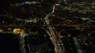 AX64_0395 - 5K stock footage aerial video bird's eye of heavy traffic on the 110 and 101 freeway interchange, Downtown Los Angeles, California, night