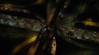 AX64_0399 - 5K stock footage aerial video bird's eye view of Highway 110 and Highway 101 interchange, Downtown Los Angeles, California, night