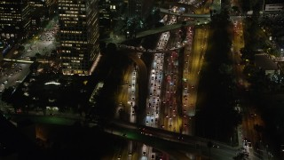 AX64_0404 - 5K stock footage aerial video of heavy traffic on Highway 110, Downtown Los Angeles, California night