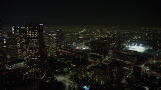 AX64_0413 - 5K stock footage aerial video of Downtown Los Angeles skyscrapers and the 110 freeway, California, night