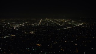 AX64_0418 - 5K stock footage aerial video of urban neighborhoods and city lights, Echo Park, Los Angeles, California, night