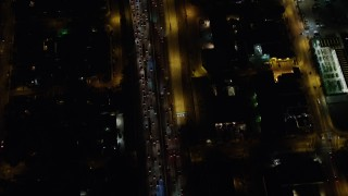 AX64_0427 - 5K stock footage aerial video tilt to bird's eye view of heavy traffic on Interstate 5, Burbank, California night