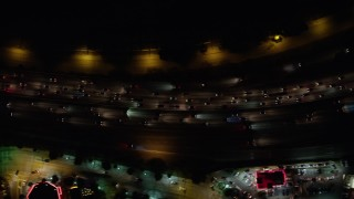 AX64_0431 - 5K stock footage aerial video of a bird's eye view of heavy I-5 traffic at night, Burbank, California