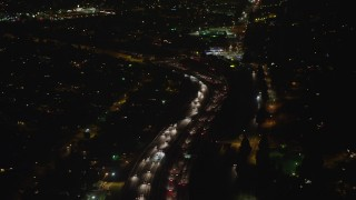 AX64_0435 - 5K stock footage aerial video of freeway traffic traveling on Interstate 5, Sun Valley, California night