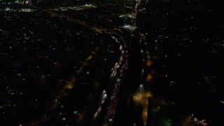 AX64_0436 - 5K stock footage aerial video of freeway traffic on Interstate 5 through Sun Valley, California night