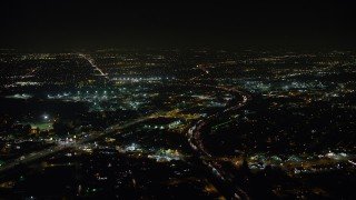AX64_0437 - 5K stock footage aerial video of Interstate 5 and San Fernando Road around warehouse building, Sun Valley, California, night