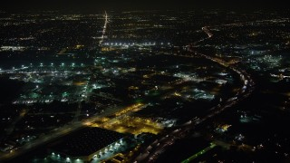 AX64_0438 - 5K stock footage aerial video of Interstate 5 and San Fernando Road, Sun Valley, California, night