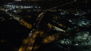 AX64_0440 - 5K stock footage aerial video of Interstate 5, warehouses, and suburban neighborhoods, Sun Valley, California, night
