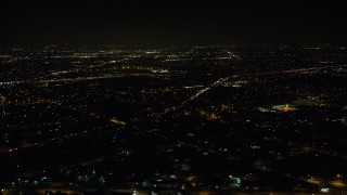 AX64_0441 - 5K stock footage aerial video of Interstate 5 and suburban neighborhoods at night, Sun Valley, California