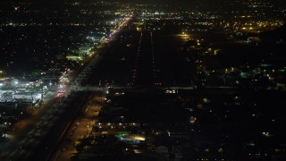 AX64_0445 - 5K stock footage aerial video of approaching a runway at Whiteman Airport, Pacoima, California, night