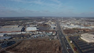 AX65_0002 - 5K stock footage aerial video follow Broadhollow Road to approach stores and shopping centers in Farmingdale, Long Island, New York, winter