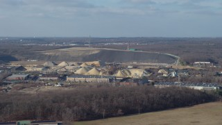 AX65_0003 - 5K stock footage aerial video approach a quarry in Melville, Long Island, New York, winter