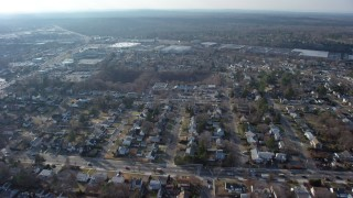 AX65_0013 - 5K stock footage aerial video of suburban residential neighborhood in Syosset, Long Island, New York, winter