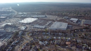 AX65_0014 - 5K stock footage aerial video of suburban residential neighborhood and big box stores in Syosset, Long Island, New York, winter