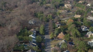 AX65_0015 - 5K stock footage aerial video flyby a suburban homes in Syosset, Long Island, New York, winter