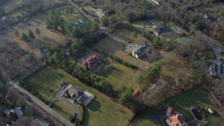 AX65_0016 - 5K stock footage aerial video of a bird's eye view of large, upscale homes in Syosset, Long Island, New York, winter